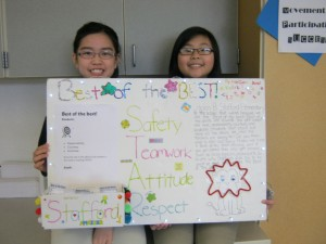 Katie and Megan with their schools that work submission poster
